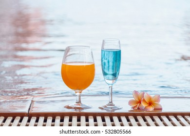 Beautiful cocktail beside on the swimming pool