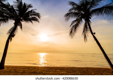 Beautiful coconut palm tree on the beach and sea with umbrella and chair on sunrise time - Vintage Filter