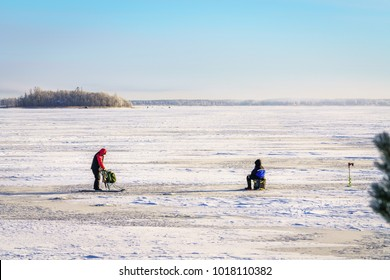 Beautiful cold winter day in the town of Vaasa, Finland. Beautiful scenery from the Finnish archipelago where people are pike fishing.
