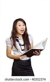 Beautiful college student reading book in her hand. She looks surprise