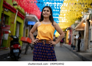 Beautiful Colombian woman with colorful outfit in the old city o
