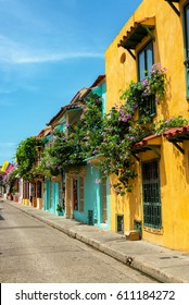 Beautiful colonial buildings covered in bougainvillea flowers in Cartagena, Colombia