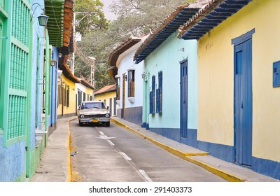Beautiful colonial houses and old car in Choroni, venezuela