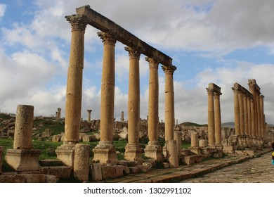 Beautiful colonnade and stone pavement of the Cardo Maximus at Jerash Archaeological Site with the ruins of the ancient Gerasa, Hellenistic and Roman Decapolis city in northern Jordan