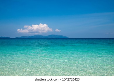 Beautiful color of sea with clouds in the nature background white sand beach at Bruer island in Myanmar.