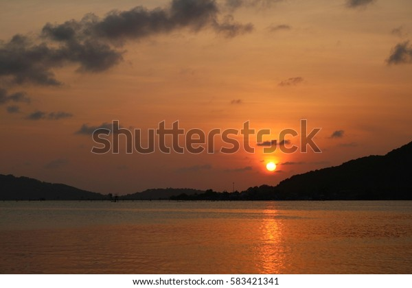 beautiful color of sky and water on sunset background