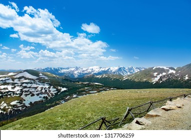 Beautiful Colorado spring landscape with green meadows and snow covered mountains. View from Trail Ridge Road. Rocky Mountains National Park. Close to Estates Park,Colorado . USA.