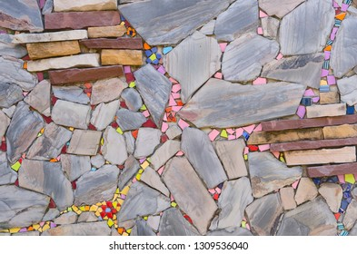 Beautiful colored ceramic pieces and  flagstone wall