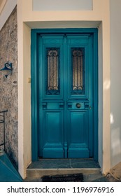 Beautiful colored door entrance into a picturesque house in the city Samothraki on Samothrace Island painted in vibrant colours