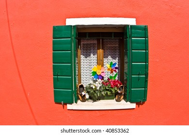 beautiful colored houses and windows  of the old fishermans  city Burano in the laguna of Venice