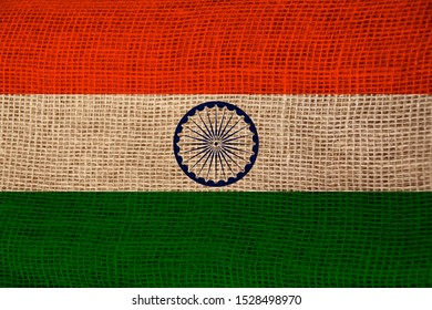 beautiful colored national flag of india state on textured fabric, concept of tourism, economy and politics, closeup