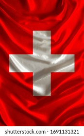 beautiful colored national flag of modern state of Switzerland on textured fabric, concept of tourism, travel, emigration