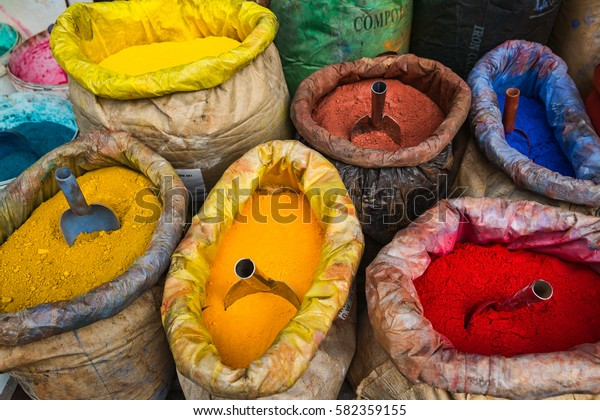 Beautiful colored paint pigment powders in sacks with scoops at the outdoor marketplace in Istanbul, Turkey.