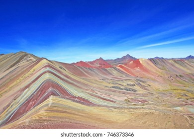 The beautiful colored Rainbow Mountain panorama near Cusco Peru. Nice view into the hole valley. Located about 20km south of Ausangate mountain.