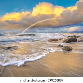 beautiful colored storm clouds over the sea beach, rainbow