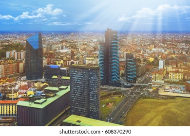 Beautiful colored toned image of Milan, Italian urban cityscape with skyscrapers and different buildings on the streets and background with the sunset