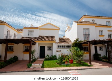 Beautiful with the colorful architecture of the city of Spain. Modern building architecture and green vegetation, trees and bushes. Mediterranean Spain. Beautiful building.