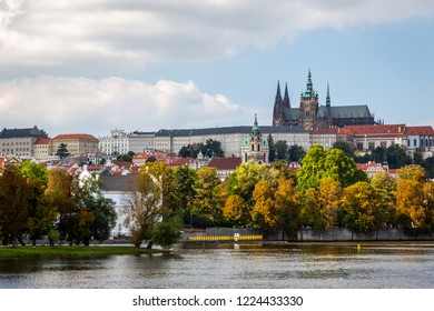 Beautiful colorful autumn cityscape view of Prague castle seen from the river.