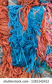 Beautiful Colorful Bales of String Remnants in Orange, Blue, Green, White, Pink, Turquoise, Aqua