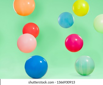 Beautiful colorful balloons with green background
