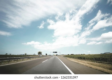 beautiful colorful bright photo of road on sunny hot summer day with blue sky with white clouds