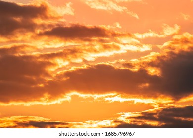 Beautiful colorful dark sunset sky with orange clouds. Nature sky background.