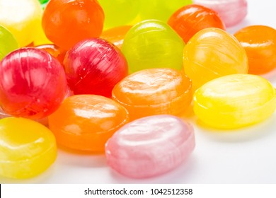 Beautiful colorful and delicious candy sweets and jelly marshmallows. different shapes and composition lollipops and marmalade isolated on abstract blurred white background. Detailed closeup shoot.