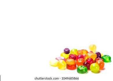 Beautiful colorful and delicious candy sweets and jelly marshmallows. Different shapes and composition lollipops marmalade isolated on abstract blurred white background. Closeup. Soft selective focus