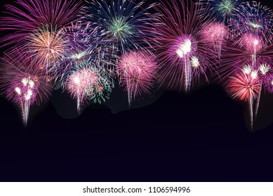 Beautiful colorful fireworks background display for celebration and anniversary day with free space for text.