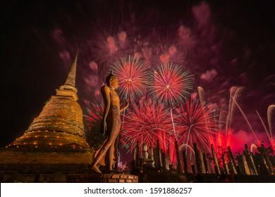 Beautiful colorful fireworks to celebrate Thai Loykrathong festival in Sukhothai historical park, Thailand