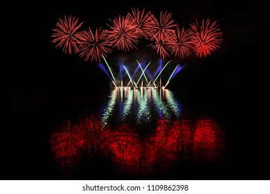 Beautiful colorful fireworks with reflections in water. Brno dam, the city of Brno-Europe. International Fireworks Competition.
