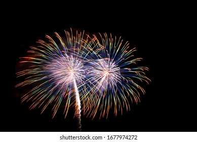 Beautiful colorful fireworks sparkle in night sky
