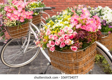 Beautiful colorful flowers in a basket of white vintage bicycle, Concept for wedding and valentine 's day.