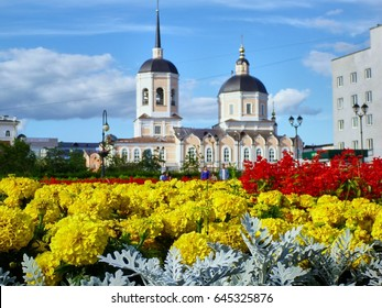 Beautiful colorful flowers at church background. Tomsk. Russia
