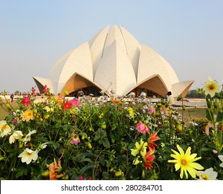 Beautiful colorful flowers in front of the temple, focused on flowers in the front, Lotus Temple, New Delhi, India