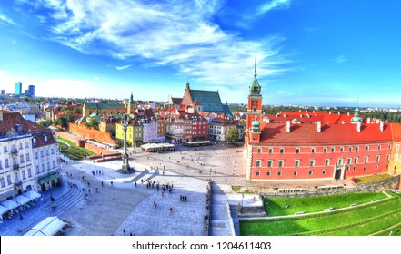 Beautiful colorful HDR aerial image of the famous Old town in Warsaw, Poland. The Royal Castle and Sigismund's Column called Kolumna Zygmunta on blue dramatic sky - wide angle image