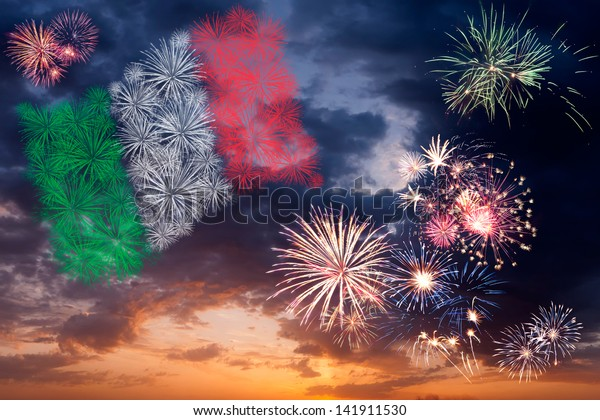 Beautiful colorful holiday fireworks with national flag of Italy, evening sky with majestic clouds