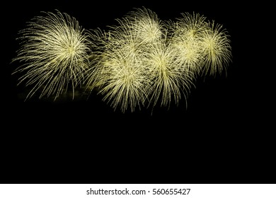 Beautiful colorful holiday fireworks on the dark sky background