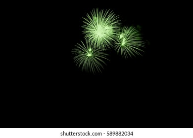 Beautiful colorful holiday fireworks on dark sky background.Colorful and Artistic Fireworks Display over the  Lake.