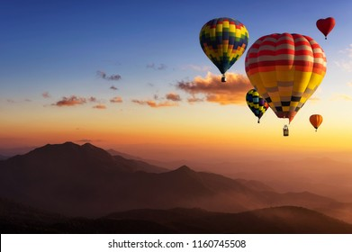 Beautiful colorful hot air balloons flying over mountain at view point Sunset of travel place, Doi inthanon, Chiang mai's Hidden Paradise in Thailand.