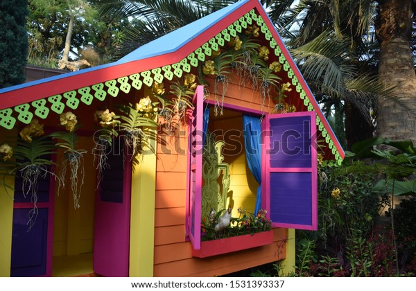 beautiful colorful hut with blue color window in the forest