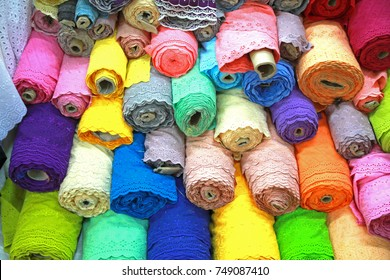 Beautiful colorful lace rolls in the fabric store.