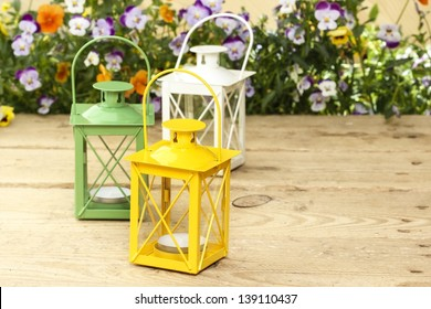 Beautiful colorful lanterns on wooden table at summer party.