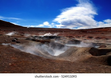beautiful colorful muddy geyser in the bolivian andean on a altitude of 5000 meters