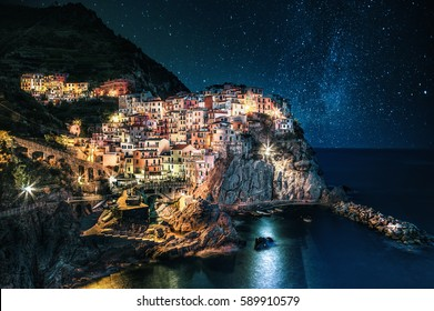 Beautiful colorful nightscape with Manarola village in the Cinque Terre (Liguria, Italy) Travel Italia