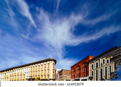 Beautiful, colorful old buildings juxtaposed against a brilliant blue sky with thin white clouds.