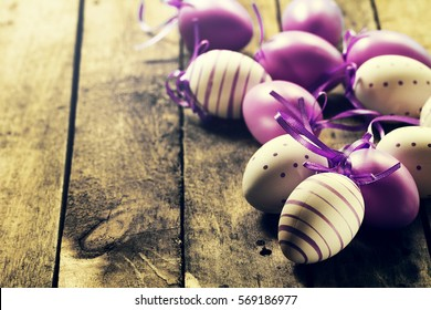 Beautiful Colorful Pastel Color Eggs on Wooden Background. Easter or Spring Concept. Horizontal with Copy Space.