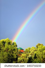 Beautiful colorful rainbow in the blue sky in the village