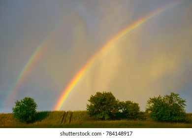 Beautiful colorful rainbow in blue sky after rain