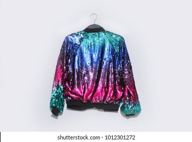 Beautiful, colorful sequins texture pattern jacket on hanging